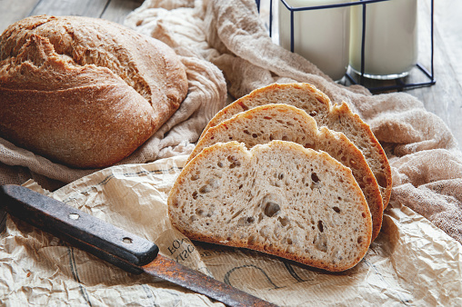 Delicious homemade sourdough rye bread on a plate and milk. Homemade baking 1125389587