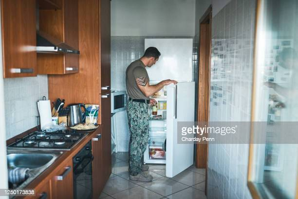 a delicious meal makes it feel like home - barracks stock pictures, royalty-free photos & images
