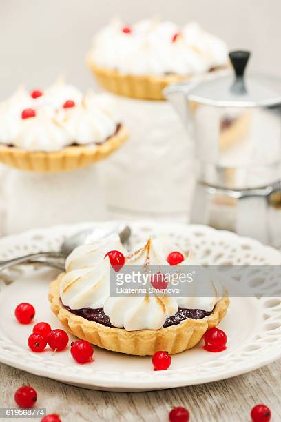 Delicious  mini tarts with berry curd and meringues