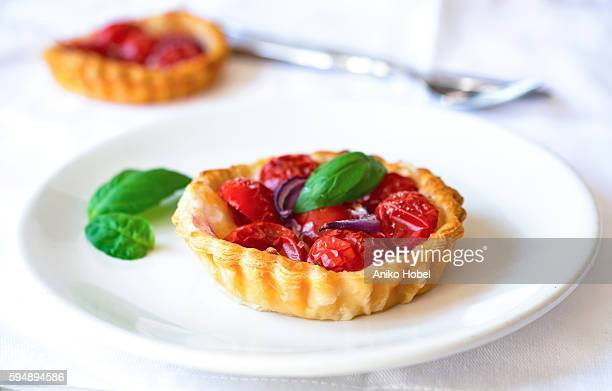 Delicious mini tomato tart with basil