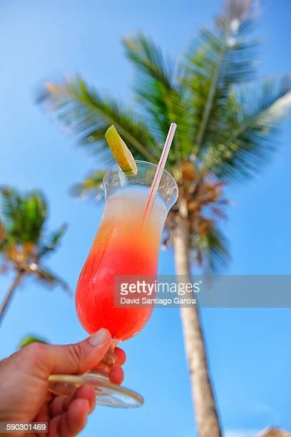 Delicious pineapple juice and grenadine background with a palm tree. Tanzania, Zanzibar Archipelago, Unguja island (Zanzibar), Nungwi