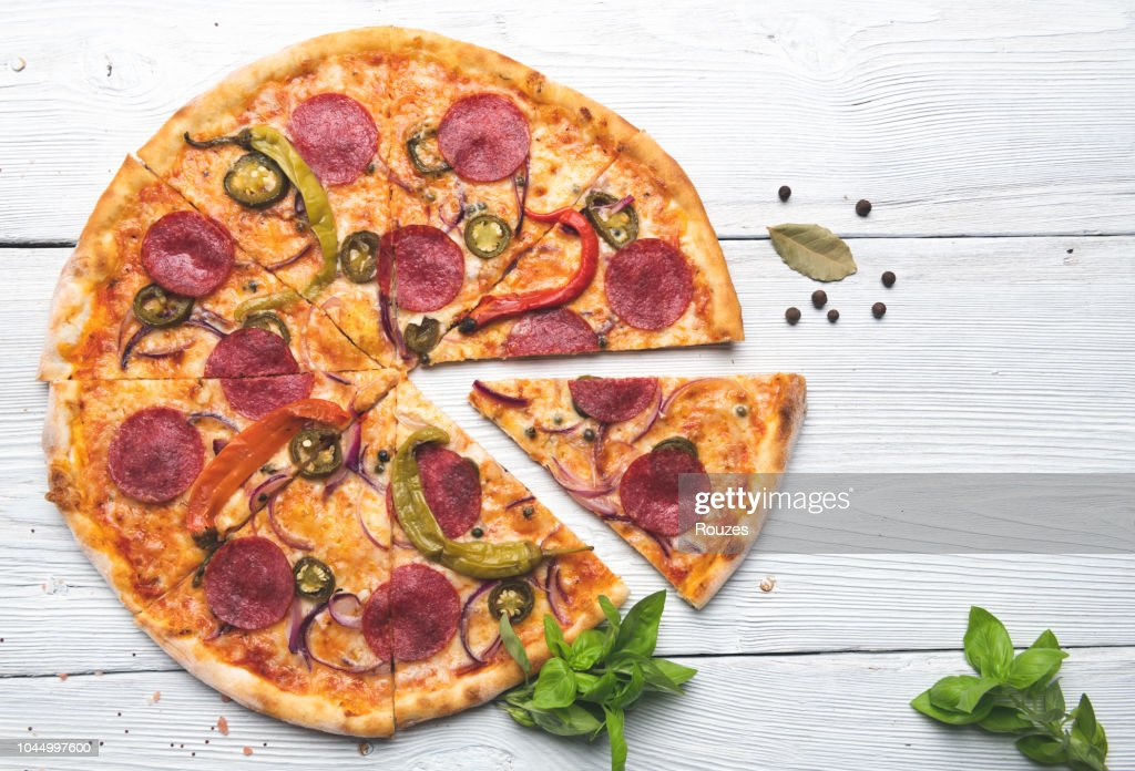 Delicious Pizza Isolated on White wooden background : Stock Photo