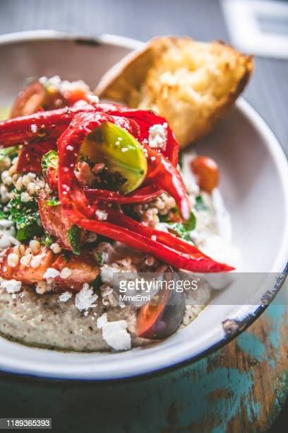 delicious plate of hummus and grilled vegetables, the perfect vegetarian lunch - mmeemil stock photos and pictures
