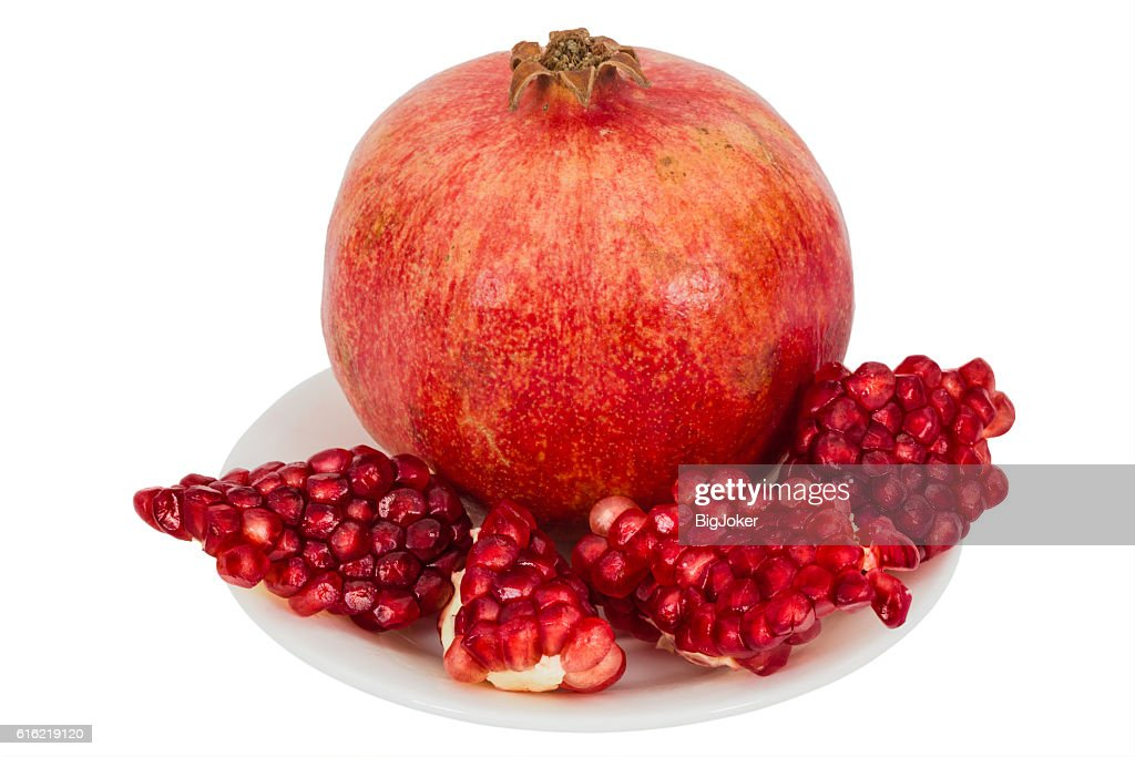 Delicious pomegranate fruit, isolated on white  background : Stockfoto