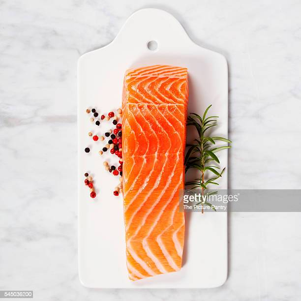 delicious portion of fresh salmon fillet with aromatic herbs and spices - smoked food fotografías e imágenes de stock
