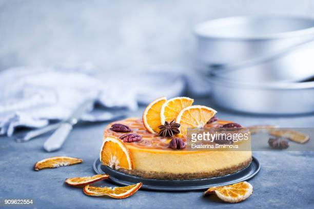 delicious pumpkin and orange cheesecake - dessert stock-fotos und bilder