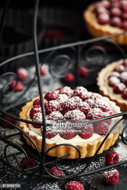 Delicious raspberry mini tarts with whipped cream