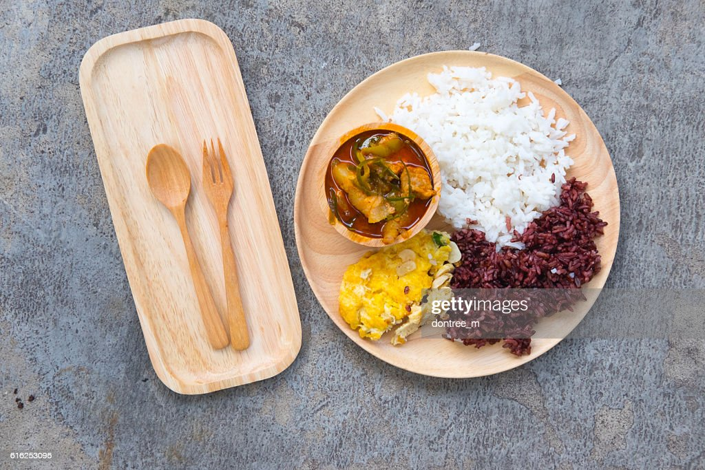 Delicious rice and red curry with pork and omelet : Stock Photo