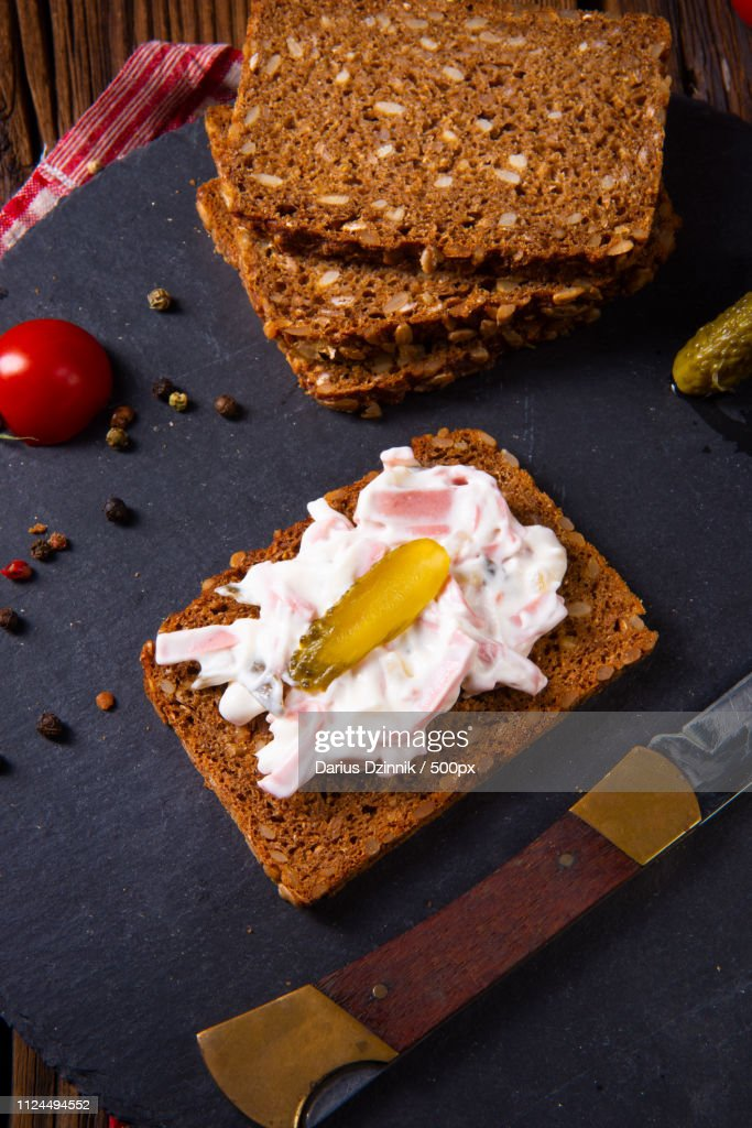 Delicious Spicy Meat Salad With Cucumber On The Black Bread : Stock-Foto