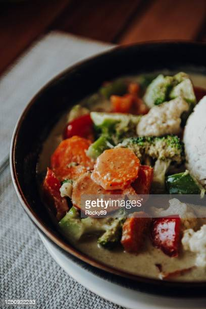delicious vegan green thai curry with different veggies served in a bowl in cape town - curry meal stock pictures, royalty-free photos & images