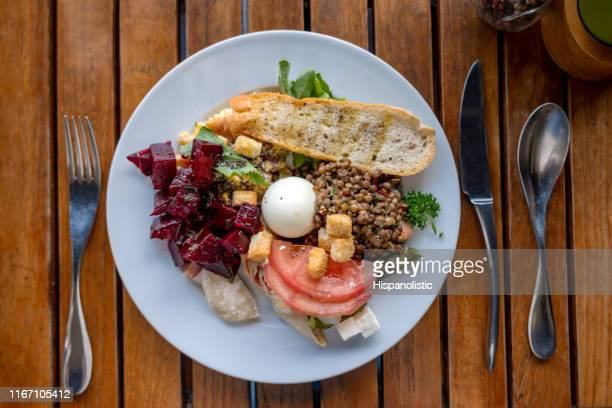 delicious vegetarian meal served - high angle view - vegetarianism stock pictures, royalty-free photos & images