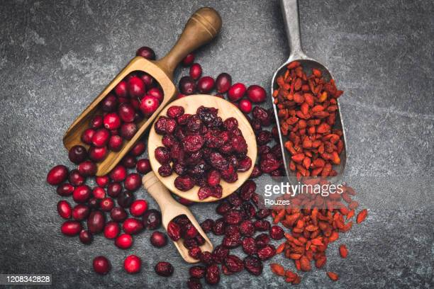 delicious wild cranberries and goji berries - cranberry stock pictures, royalty-free photos & images