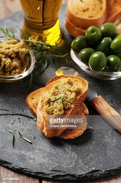 Deliciuos crostini with olive paste
