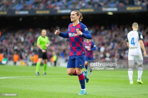 A delighted goalscorer Antoine Griezmann of Barcelona runs towards Luis Suarez of Barcelona who provided the assist for the first goal of the match...