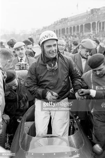 A delighted Jean Behra stands up in his Ferrari at the end of the nonChampionship BARC '200' race which he has just won at Aintree 19th April 1959