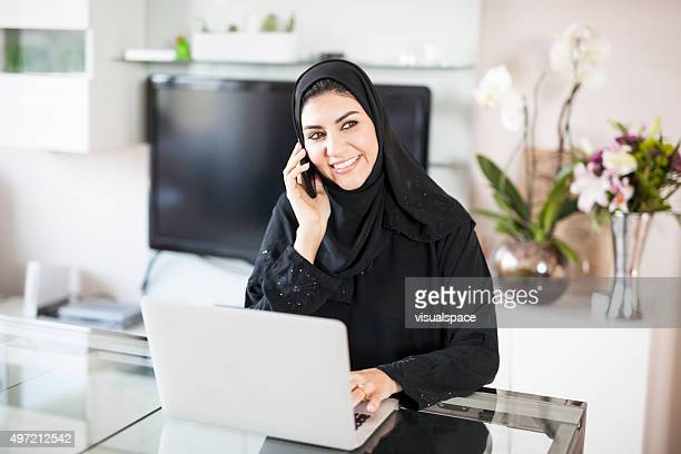 Delighted Muslim Woman Working At Home