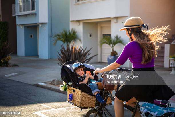 Delighted Toddler Riding Cargo Bike with Mom