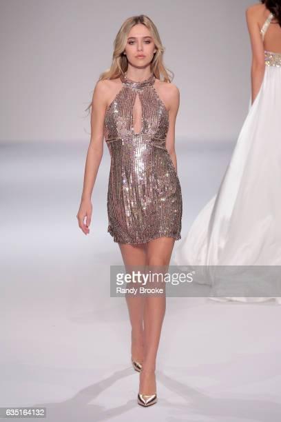 Delilah Hamlin walks the runway at the Sherri Hill NYFW Fall 2017 Runway Show during New York Fashion Week at Gotham Hall on February 13 2017 in New...