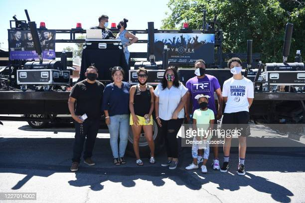 Delilah Juarez poses for a photo during a birthday parade hosted by Tyler Robinson Foundation in front of her home on May 25 2020 in Las Vegas Nevada