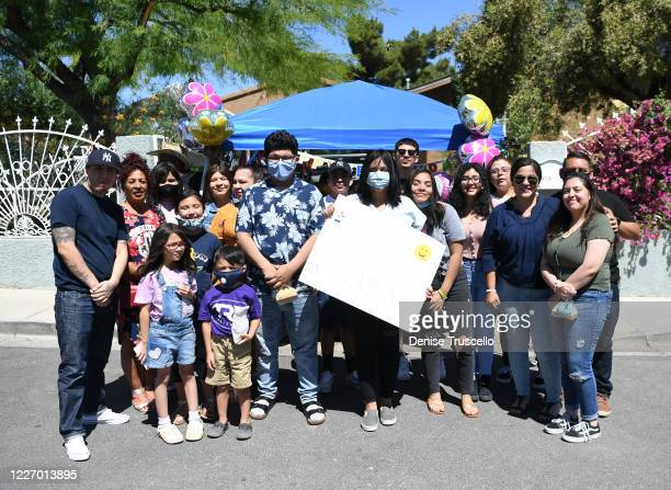 Delilah Juarez poses for a photo with her family during a birthday parade hosted by Tyler Robinson Foundation in front of her home on May 25 2020 in...