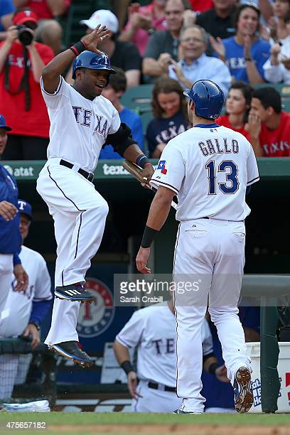 Delino DeShields and Joey Gallo of the Texas Rangers celebrate in the dugout during the first inning during a game against the Chicago White Sox at...