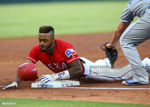 Delino DeShields of the Texas Rangers beats the tag on third base in the third inning against the Kansas City Royals at Globe Life Park in Arlington...