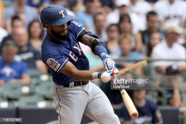 Delino DeShields of the Texas Rangers breaks his bat on a foul ball in the ninth inning against the Milwaukee Brewers at Miller Park on August 11...