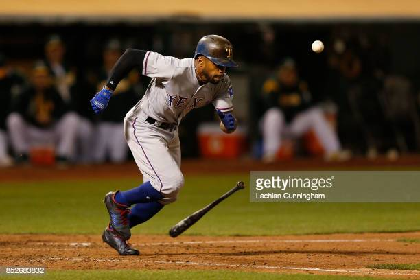 Delino DeShields of the Texas Rangers bunt grounds out in the eighth inning against the Texas Rangers at Oakland Alameda Coliseum on September 23...