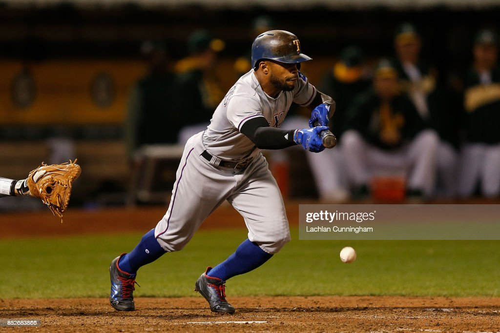 Delino DeShields #3 of the Texas Rangers bunt grounds out in the eighth inning against the Texas Rangers at Oakland Alameda Coliseum on September 23, 2017 in Oakland, California.