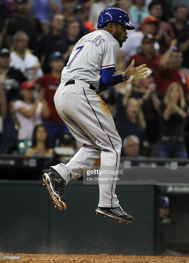 Delino DeShields #7 of the Texas Rangers celebrates his game-tying run during the eighth inning against the Houston Astros at Minute Maid Park on May 4, 2015 in Houston, Texas.