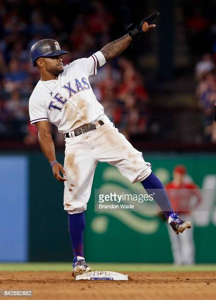 Delino DeShields of the Texas Rangers celebrates stealing second during the fifth inning of a baseball game against the Los Angeles Angels of Anaheim...