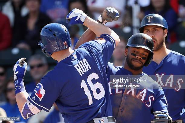Delino DeShields of the Texas Rangers celebrates with Ryan Rua after Rua hit a tworun home run against the Kansas City Royals during the first inning...