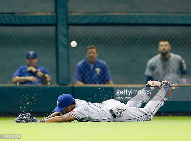 Delino DeShields of the Texas Rangers dives but misses a line drive off the bat of Carlos Correa of the Houston Astros in the third inning at Minute...