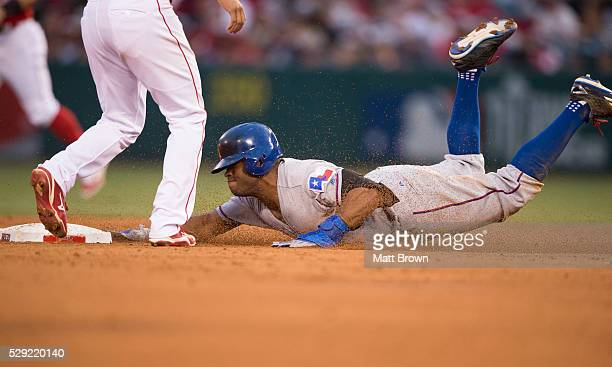 Delino DeShields of the Texas Rangers dives into second base during the game against the Los Angeles Angels of Anaheim at Angel Stadium of Anaheim on...