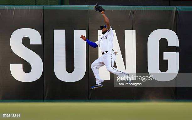 Delino DeShields of the Texas Rangers fails to pull in a fly ball hits a by Jose Abreu of the Chicago White Sox in the top of the first inning at...