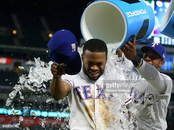 Delino DeShields of the Texas Rangers gets showered with water by Elvis Andrus of the Texas Rangers after the 53 win over the Seattle Mariners at...