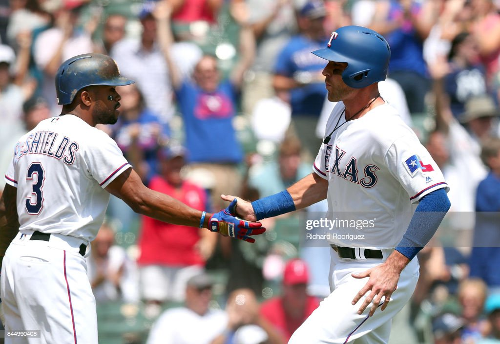 Delino DeShields #3 of the Texas Rangers greets Will Middlebrooks #15 of the Texas Rangers who scored on a double by Brett Nicholas in the 5th inning of a game at Globe Life Park in Arlington on September 9, 2017 in Arlington, Texas.