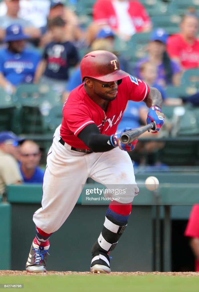 Delino DeShields #3 of the Texas Rangers hits a bunt against the Los Angeles Angels of Anaheim at Globe Life Park in Arlington on September 3, 2017 in Arlington, Texas.