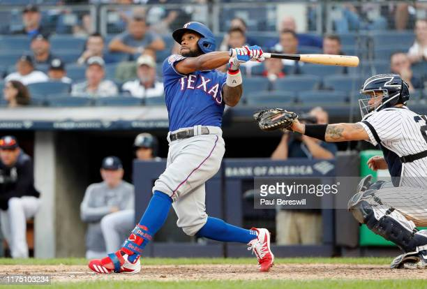 Delino DeShields of the Texas Rangers hits a three run home run in an MLB baseball game against the New York Yankees on September 2 2019 at Yankee...