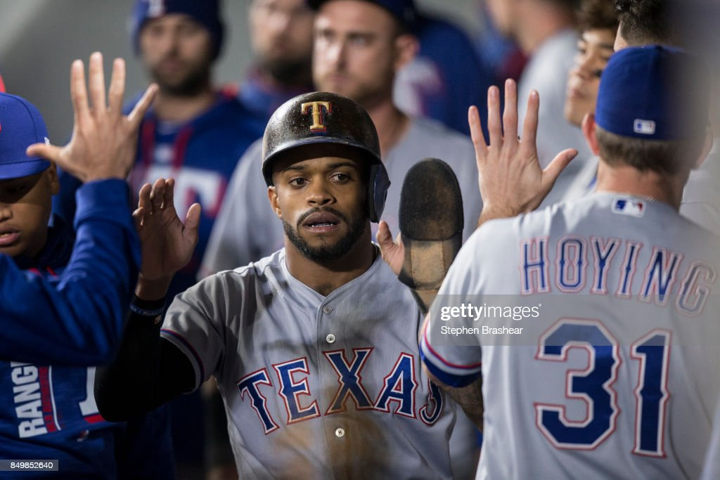 Delino DeShields #3 of the Texas Rangers is congratulated by teammates in the dugout after scoring a run on a hit by Elvis Andrus #1 of the Texas Rangers off of relief pitcher Nick Vincent #50 of the Seattle Mariners during the eighth inning of a game at Safeco Field on September 19, 2017 in Seattle, Washington.