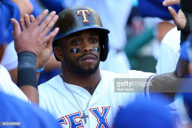 Delino DeShields of the Texas Rangers is congratulated for scoring in the eighth inning against the New York Yankees at Globe Life Park in Arlington...