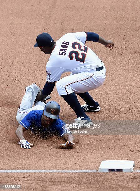 Delino DeShields of the Texas Rangers is out at third base as Miguel Sano of the Minnesota Twins applies the tag during the seventh inning of the...