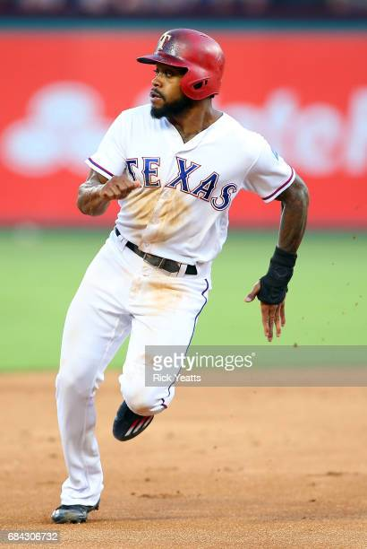 Delino DeShields of the Texas Rangers looks back running the bases to third in the second inning against the Philadelphia Phillies at Globe Life Park...