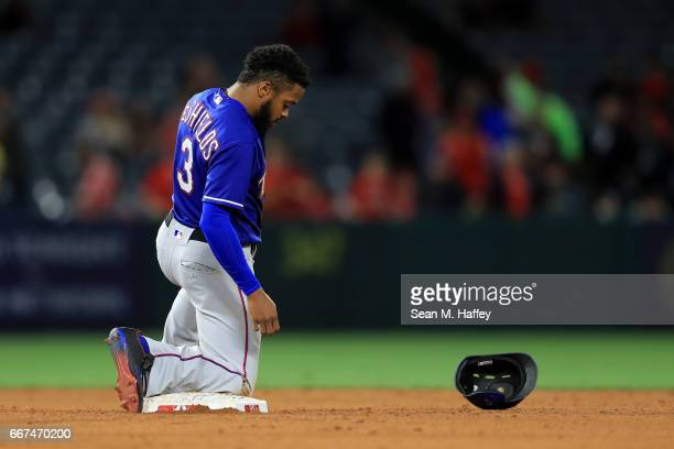 Delino DeShields of the Texas Rangers looks on after being tagged out stealing second base during the tenth inning of a game against the Los Angeles...