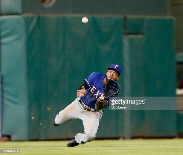 Delino DeShields of the Texas Rangers makes a diving attempt on a fly ball by Yuli Gurriel of the Houston Astros in the seventh inning at Minute Maid...
