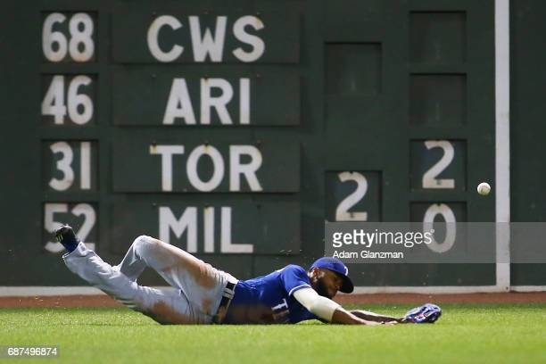 Delino DeShields of the Texas Rangers misses a fly ball in sixth inning of a game against the Boston Red Sox at Fenway Park on May 23 2017 in Boston...