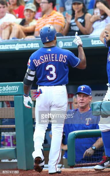 Delino DeShields of the Texas Rangers points to the sky after hitting a home run in the first inning against the Seattle Mariners at Globe Life Park...