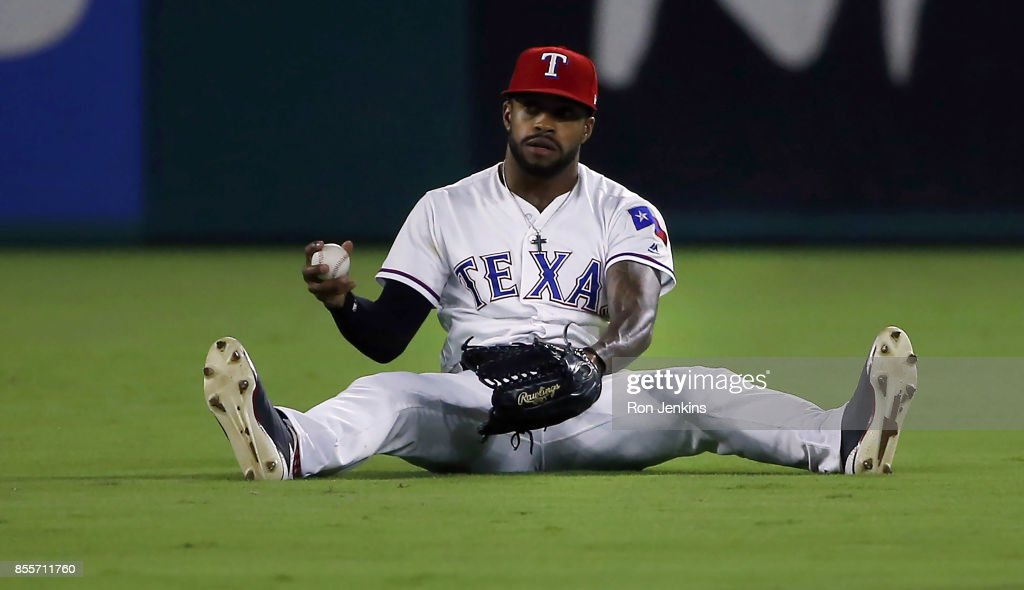Delino DeShields #3 of the Texas Rangers reacts after catching a fly ball off the bat of Josh Phegley #19 of the Oakland Athletics during the fifth inning at Globe Life Park in Arlington on September 29, 2017 in Arlington, Texas.