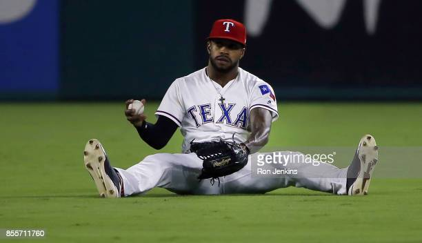 Delino DeShields of the Texas Rangers reacts after catching a fly ball off the bat of Josh Phegley of the Oakland Athletics during the fifth inning...