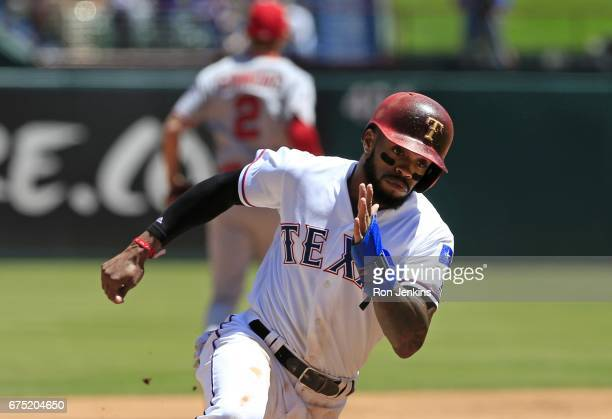 Delino DeShields of the Texas Rangers rounds third base on his way to scoring a run against the Los Angeles Angels of Anaheim in the first inning at...